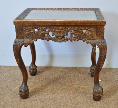 Lot 495 - Decorative carved mahogany occasional table.