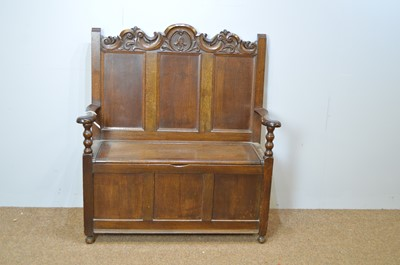 Lot 415 - Mid 20th C carved oak hall seat in the 17th C taste.