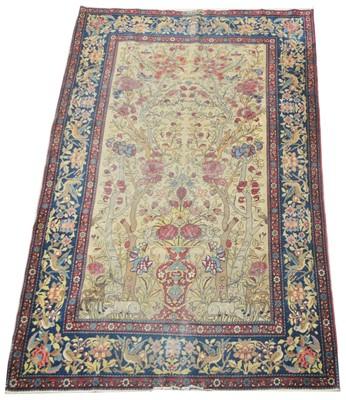 Lot 633 - An antique Kirman rug.