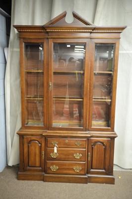 Lot 211 - A modern mahogany display cabinet.