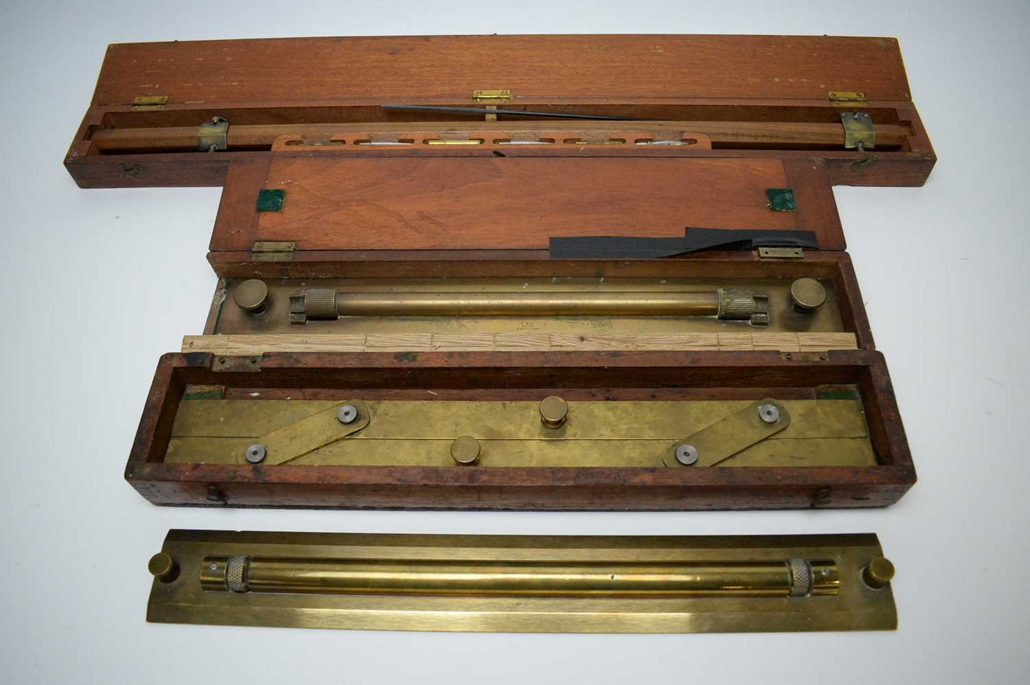 Lot 746 - Draughtsman's 23in. beam compass MkII; and three brass parallel rules.
