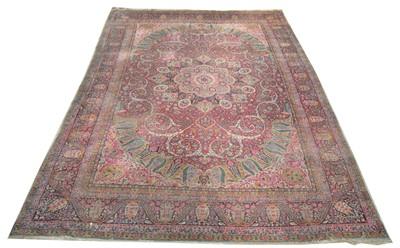 Lot 621 - A Kirman carpet.
