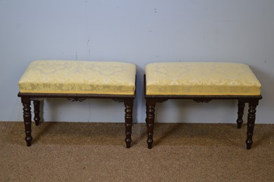 Lot 28 - Pary of Regency-style stained wood stools.