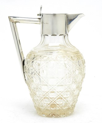 Lot 137 - A late Victorian cut glass and silver-mounted claret jug.