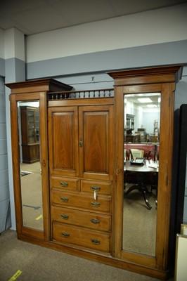 Lot 224 - An early 20th C walnut wardrobe.