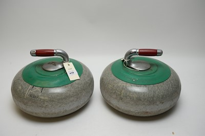 Lot 418 - A pair of curling stones