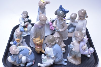 Lot 225 - Eleven various Nao Disney Collection figurines.