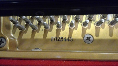 Lot 744 - K. Kawai black lacquered baby grand piano and stool.
