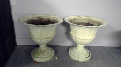 Lot 547 - A pair of cast metal urns