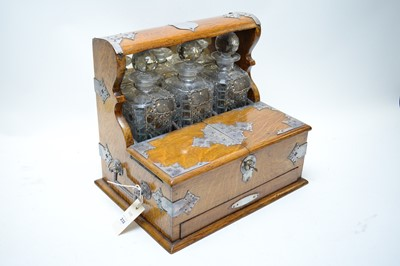 Lot 232 - An early 20th C tantalus.