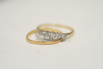 Lot 9 - A five stone diamond ring; and a wedding band.