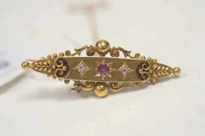Lot 20 - An Edwardian ruby and diamond set brooch.
