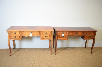 Lot 159 - A pair of modern walnut dressing tables/desks in the French taste
