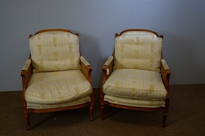 Lot 124 - A pair of 20th Century French-style beechwood Bergere armchairs.