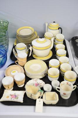 Lot 315 - A Foley china yellow and black coloured tea service.