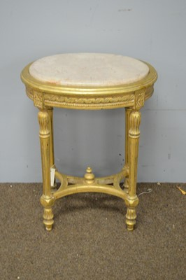 Lot 60 - Oval 20th C marble and gilt side table.