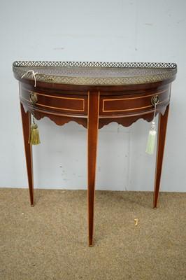 Lot 4 - Mahogany and line inlaid semi-circular side table.