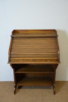 Lot 148 - Early 20th C oak roll-top desk.