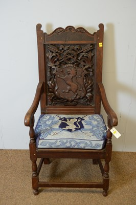 Lot 146 - Ceremonial-style carved oak open arm chair with crest and motto.