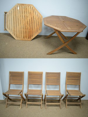 Lot 90 - 20th Century teak garden table and four chairs