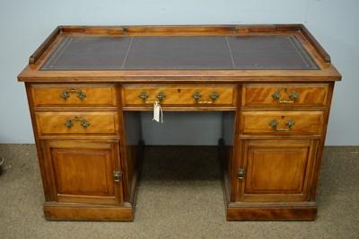 Lot 27 - A walnut pedestal desk