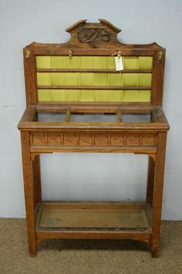 Lot 29 - Edwardian oak stick stand.