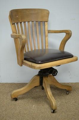 Lot 33 - Vintage beechwood office swivel chair.
