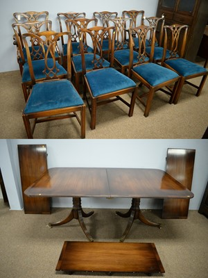 Lot 88 - Chapmans: twelve chairs and a twin pedestal dining table.