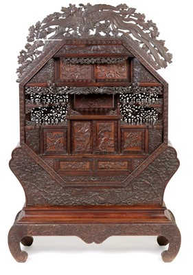 Lot 847 - A Japanese carved netsuke display cabinet.