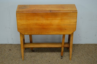 Lot 34 - Early 20th C walnut Sutherland table.