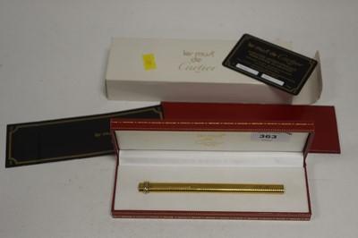 Lot 363 - A Must de Cartier gold-painted ballpoint pen.
