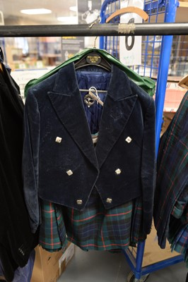 Lot 499 - A tartan kilt and jacket and silver brooch