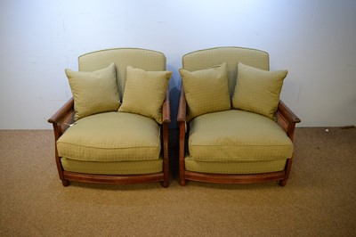 Lot 15 - Pair of Ercol teak Bergere chairs.