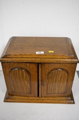 Lot 450 - Early 20th C oak smoker's cabinet.
