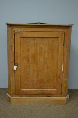 Lot 24 - 19th C stripped pine corner cabinet.
