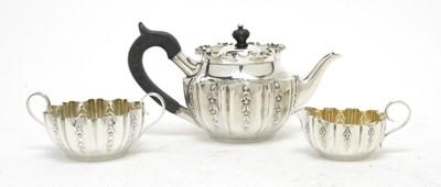Lot 162 - A Victorian three-piece bachelor's tea service.