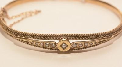 Lot 204 - A late Victorian yellow metal bangle