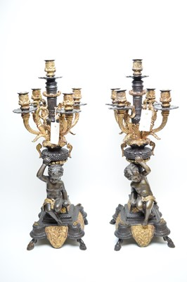 Lot 312 - Pair of repro bronzed and giltmetal four-branch candelabra.
