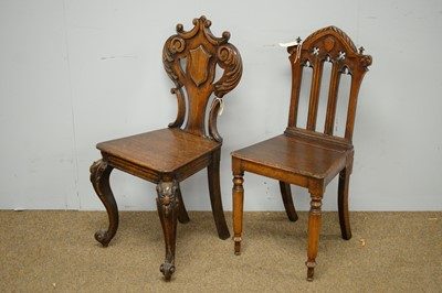Lot 7 - Two Victorian oak hall chairs.