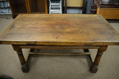 Lot 110 - Substantial 17th C style oak draw leaf dining table.