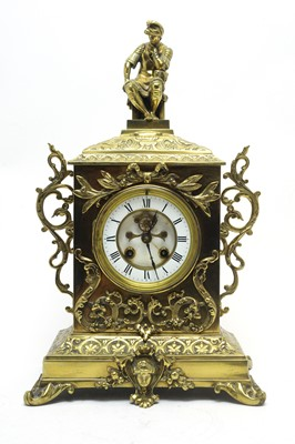 Lot 762 - An early 20th C brass-cased mantel clock.
