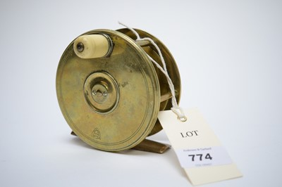 Lot 774 - A brass fishing reel.