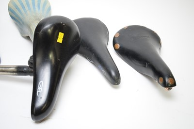 Lot 729 - A Brooks Professional saddle; and five others.