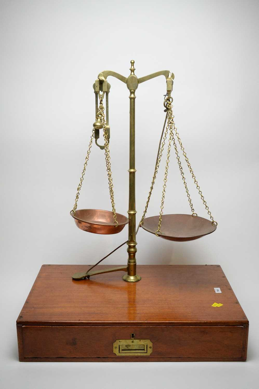 Lot 768 - A set of brass balance scales.