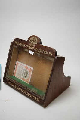 Lot 767 - A tobacconist's mahogany shop display cabinet; and thee books on cigars.