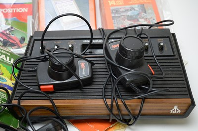 Lot 781 - Two vintage Atari video computer game consoles and accessories.