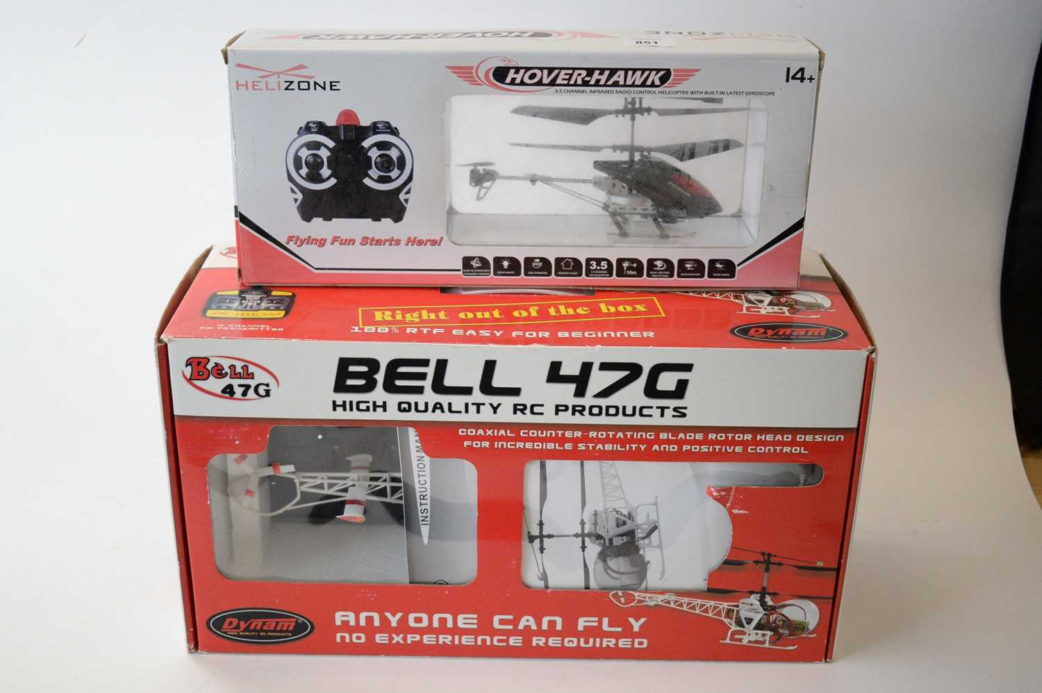 Lot 851 - Two radio controlled model helicopters.