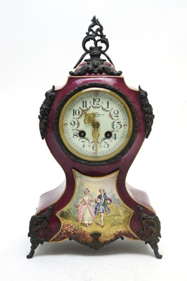 Lot 763 - A 19th C French porcelain mantel clock.