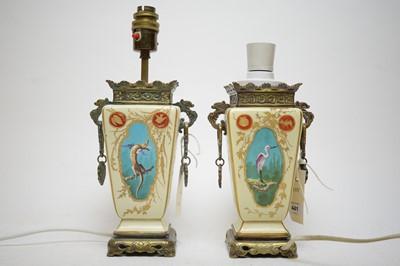 Lot 441 - A pair of Japonainse metal mounted ceramic lamps