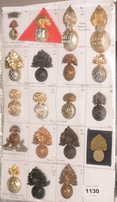 Lot 1130 - A collection of 19 Fusilier Regiment cap badges.